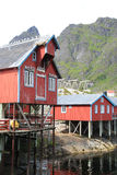 Old  lofts on spilings of the harbour of A Stock Photos