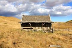 Old Log Barn with Sky Stock Photo