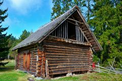 Old log barn with a thatched roof Stock Image