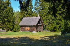 Old log barn with a thatched roof Royalty Free Stock Photo
