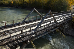 Old log bridge over river near Haines Junction, Yukon Stock Images
