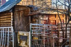 Old log building with dilapidated walls royalty free stock image