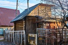 Old log building with dilapidated walls stock images