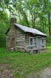 Old Log Cabin. Log Cabin with stone chimney Stock Photo