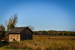 Old Log Cabin in Field in Wisconsin. Old log cabin located in a field in Kettle Moraine State Park in Wisconsin in Fall Royalty Free Stock Image