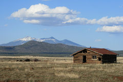 Old log cabin and mountain Stock Photography