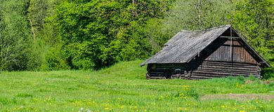 Old log cabin. Wide panorama stock photography
