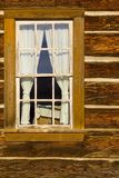 Old log cabin window Stock Photo