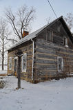 Old log cabin in winter Stock Photo
