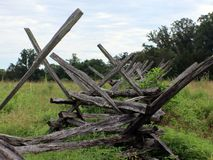 Old, Civil war style log fence. An old log fence with overgrowth royalty free stock photos