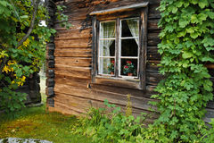Old log house. And window with mullions Stock Photo