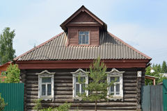 Old log house with carved platbands Stock Image