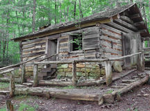 Old Log house on hill in woods. Royalty Free Stock Photography