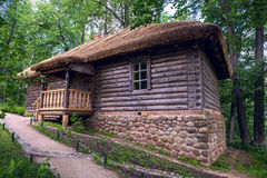 Old log house with one window Royalty Free Stock Photo
