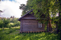 Old log house with one window Royalty Free Stock Image