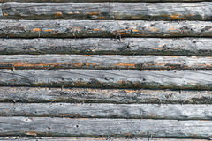 Old log house wood wall with highlight from sun on the right side Royalty Free Stock Photos