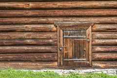 Free Old Log House Wood Wall With Closed Door And Padlock On It Stock Photo - 57717230