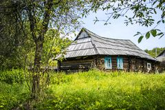 Log house with wooden roof Stock Photo