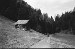 Old log huts for animal shelters in the Swiss Alps, with analogue photgraphy - 2. Old log huts for animal shelters in the Swiss Alps, with analogue photgraphy royalty free stock photos