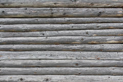 Old log wall background. Wall of one old rural house Royalty Free Stock Image