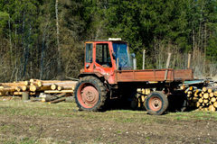 Old logging tractor in field Stock Image