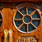 Old london door in  and wood ancien abstract hinged Royalty Free Stock Photography