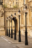 Old London Street Lamps. A group of six old London cast iron street lamps, London, England, UK Stock Image