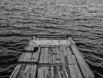 Lonely mooring on the lake. Old lonely mooring on the lake Royalty Free Stock Image