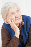 Old lonely woman. Staying alone at home Stock Images