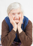 Old lonely woman. Staying alone at home Royalty Free Stock Image