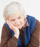Old lonely woman. Staying alone at home Royalty Free Stock Photos