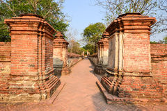 Old temple walkway. Old long brick walkway in temple Royalty Free Stock Photos