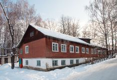 Old long wooden house, winter time royalty free stock photography