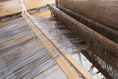 Old loom. Cotton is raw for weave tools to work natural textile fiber. Close-up.  stock photo