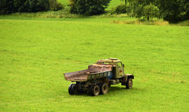 Old lorry on green meadow Royalty Free Stock Photos