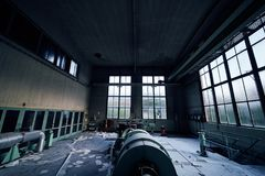 Old lost abandonend industrial factory building powerhouse. Lostplace old lost abandonend factory building powerhouse in green stock image