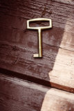 Old lost key on floorboards Stock Images