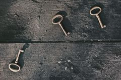 Old lost key on floorboards Stock Image