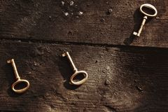 Old lost key on floorboards Royalty Free Stock Image