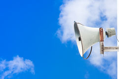 Old loudspeaker against cloudy blue sky Stock Photos