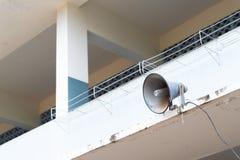 Old loudspeaker. Old loudspeaker on tower in school background Stock Image