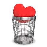 Old Love. Red heart in a wastebasket. White background Royalty Free Stock Image