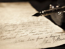 Old love letter. Love letter and antique quill on a black background Stock Photo