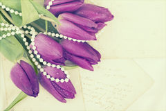 Old love letters and purple tulips Royalty Free Stock Photography