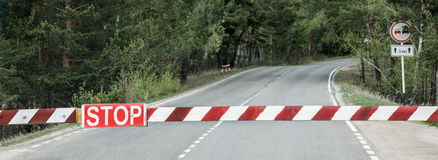 Old lowered barrier. Old lThe old barrier blocked the road into the forestowered barrier Stock Image