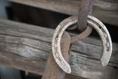 Old lucky horse shoe on wood fence shoe came off stock images