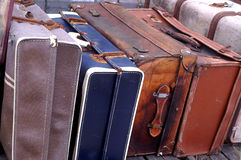 Old Luggage cases. Retro old luggage bags and cases stacked together, leather and used and vintage style Royalty Free Stock Photography