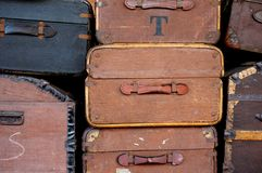 Old luggage sitting on a trolley Royalty Free Stock Images