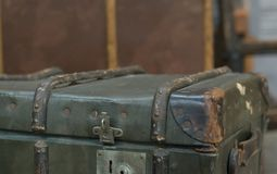 An old luggage trunk. An old battered trunk with lock open Stock Photo