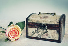 Old luxury vintage chest and a rose Royalty Free Stock Images